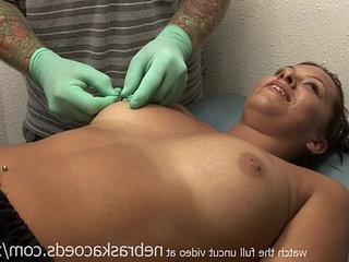 hot brunette girl getting her nipples pierced on vacation