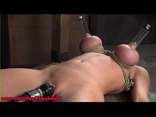 Toyed BDSM slave gets her feet canned