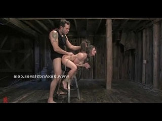 Busty slaves tied in violent video