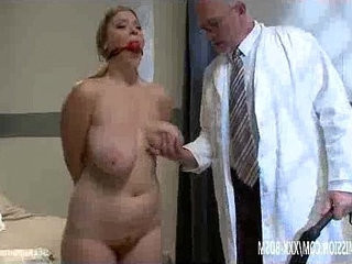 Cosmetic surgery doctor checks the patients condition